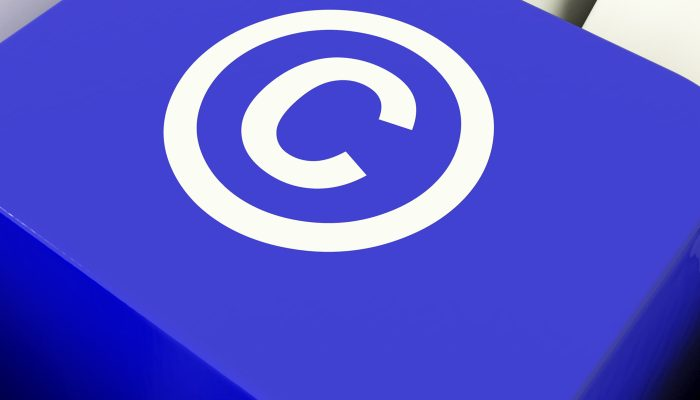Copyright Computer Key In Blue Showing Patent Or Trademarks